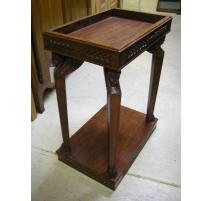 Table-console en bois exotique sculpté,