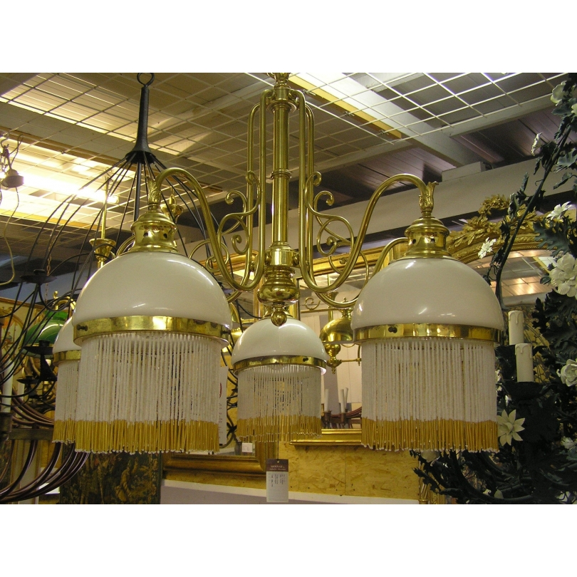 Brass chandelier and globes in opaline
