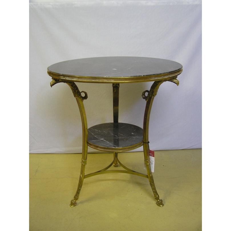 "Guéridon ""Tête d'Aigle"" en bronze doré,"
