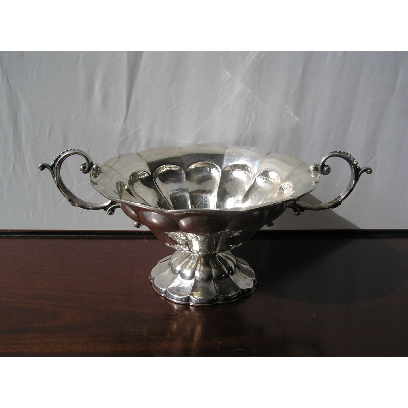 Silver cup festooned with punch