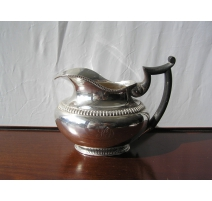 Milk jug in silver and wooden handle