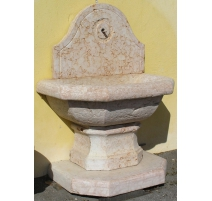 Wall fountain in pink marble