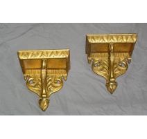 Paire de consoles en bois doré
