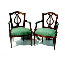 Pair of Louis XVI armchairs, Berne. Back lyre.
