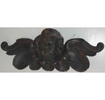 Tête d'ange en bois sculpté noirci