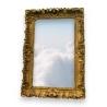 Miroir Régence sculpté et doré.