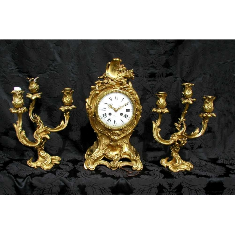 Pendule et paire de chandeliers, COLLIN.