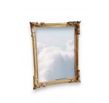 Miroir Louis XV en bois sculpté doré