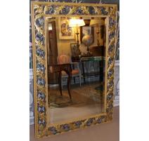 Miroir cadre en bois sculpté doré et