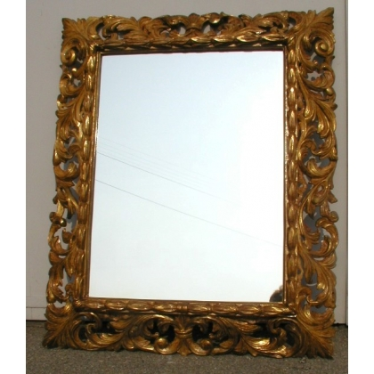 Miroir, en bois sculpté.
