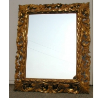 Mirror, carved in wood.