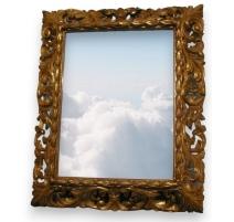 Spiegel in holz geschnitzt.