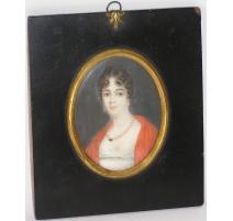 "Miniature ""Femme"", signée et datée 1810."