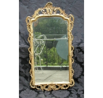 Mirror, gilt wood and plaster frame.