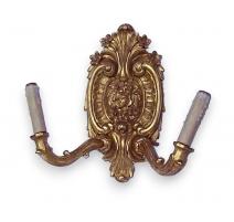 Paire d'appliques style Louis XV en bois doré