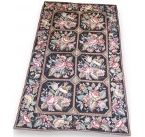 Una alfombra con puntos pequeños, fondo negro y