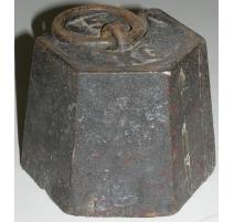 El equilibrio de peso, 5 kilos de hierro fundido.