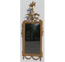 Miroir Louis XVI, en bois doré décapé.
