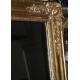Miroir Napoléon III rectangulaire doré.