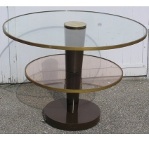 Pedestal redondo de mesa, vidrio y metales.