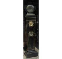 Morbier pendulum, wooden flooring in ebony