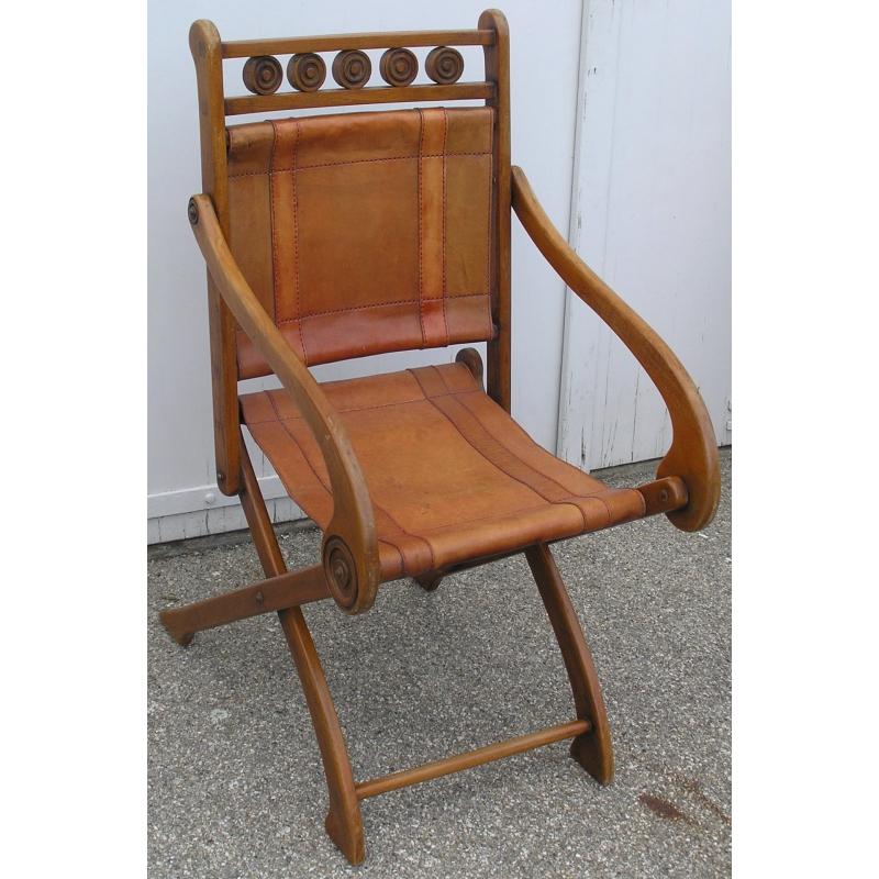 fauteuil pliant en bois et cuir sur moinat sa antiquit s d coration. Black Bedroom Furniture Sets. Home Design Ideas