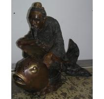 """Sculpture """"Homme montant un poisson"""""""