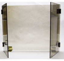 Firewall modernist smoked glass and gilded brass