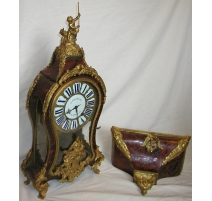 Louis XV clock, red horn. Signed JOUARD.