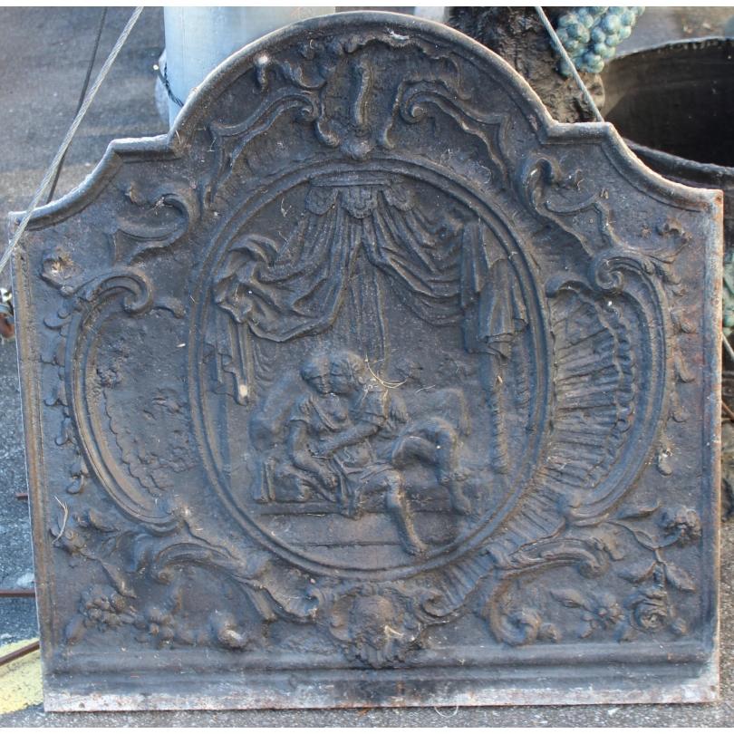 Plaque de cheminée style  Régence en fonte