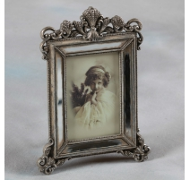 Photo frame in aged mirror, small