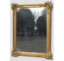 Miroir Louis XVen bois sculpté, glace au mercure
