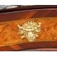 Commode Louis XV galbée en bois fruitié
