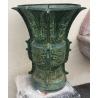 Paire de cache-pots ronds en bronze vert