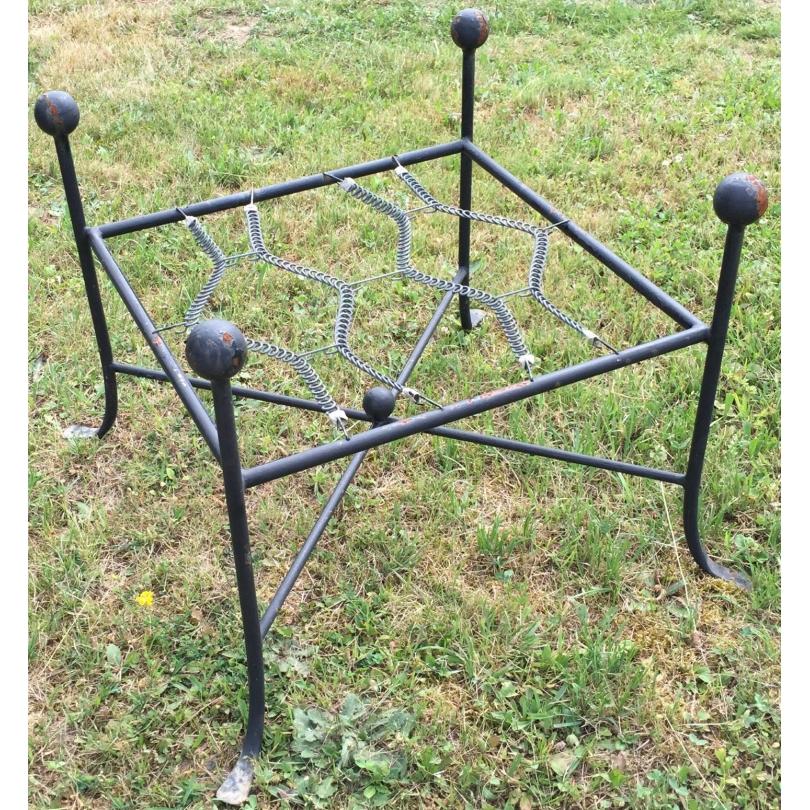 Tabouret de jardin en fer forgé noir