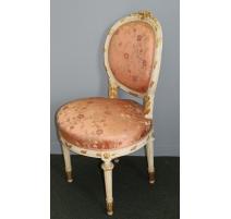 Suite de quatre chaises style Louis XVI sculptées