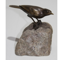 Fauvette en bronze, signé REUSSNER