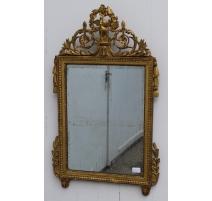 Miroir Louis XVI en bois doré décor d'oiseaux