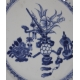 Assiette en porcelaine décor vase