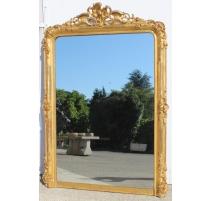 Miroir Napoléon III a fronton richement sculpté