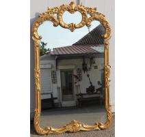 Miroir style Régence en bois doré
