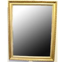 Miroir style Louis XVI en bois doré