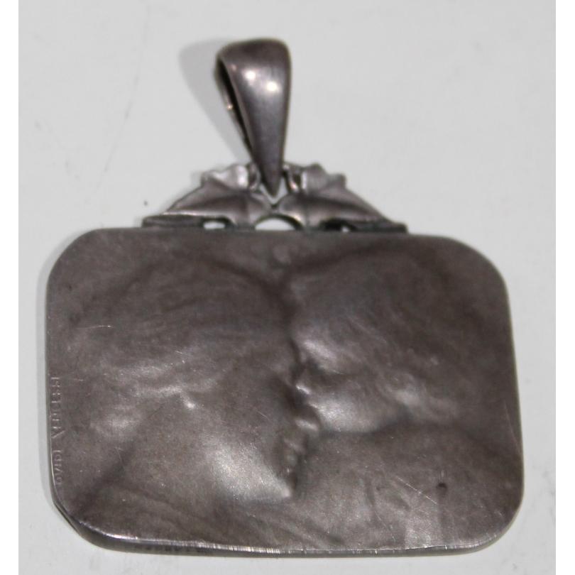 Médaille en argent signée Ovide YENCESSE