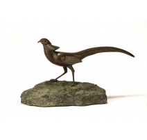 Faisan en bronze sur une pierre, signé REUSSNER
