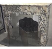 Cheminée Louis XVI en marbre blanc veiné