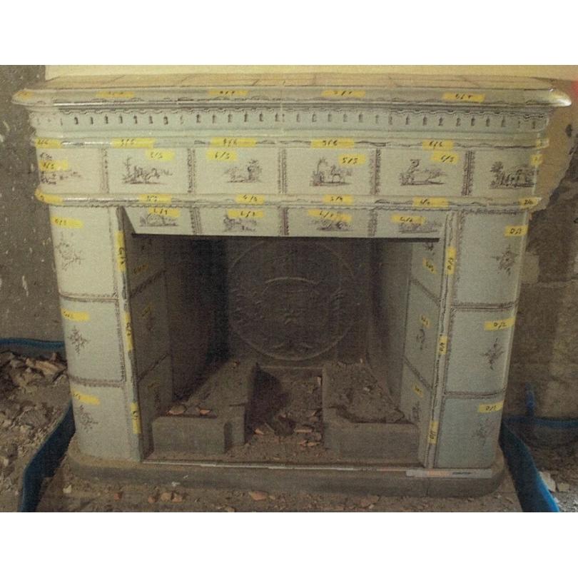 Poêle à catelles transfomé en cheminée