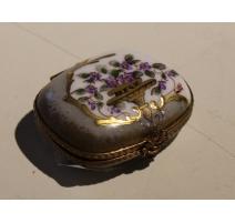 Boite en porcelaine de Limoges décor urne de fleur