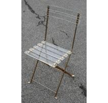 Chaise pliante en plexiglas et laiton