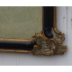 Miroir Régence en bois sculpté doré et noir