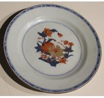 Assiette en porcelaine décor fleurs bleu et orange
